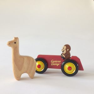 Curious George and a Friendly Llama